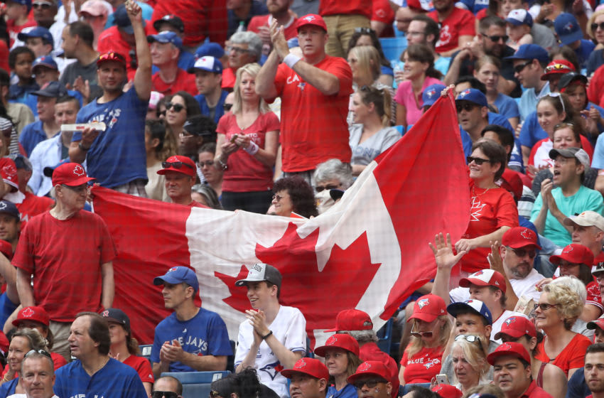 Toronto Blue Jays fans unfurl a Canadian flag on Canada Day during MLB game action against the Boston Red Sox at Rogers Centre on July 1, 2017 in Toronto, Canada. (Photo by Tom Szczerbowski/Getty Images)