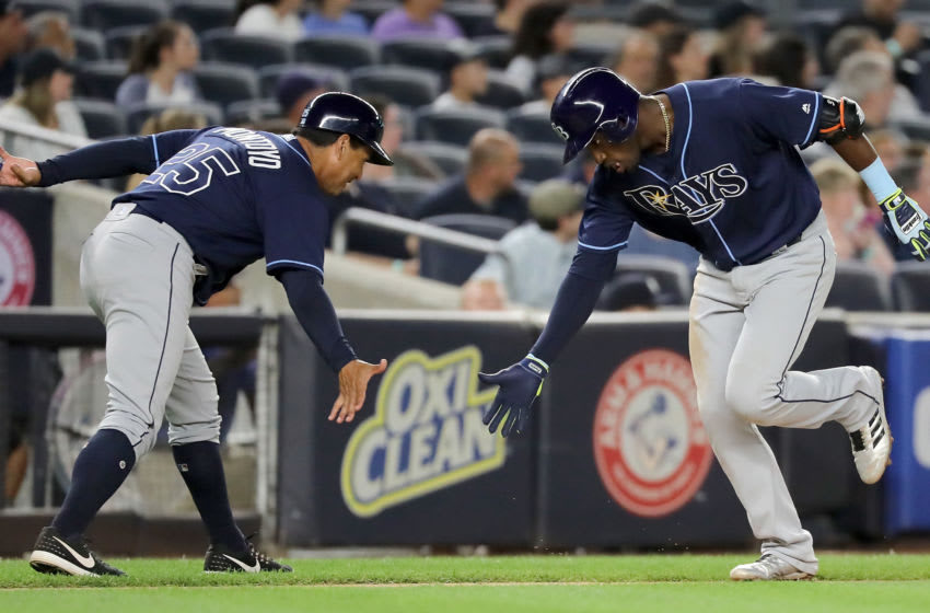 NEW YORK, NY - SEPTEMBER 27: Adeiny Hechavarria #11 of the Tampa Bay Rays (R) slaps hands with Charlie Montoyo #25 after hitting a solo home run in the fifth innning at Yankee Stadium on September 27, 2017 in the Bronx borough of New York City. (Photo by Abbie Parr/Getty Images)