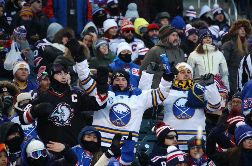 Fans bundle up against the cold during the game between the New York Rangers and the Buffalo Sabres during the 2018 Bridgestone NHL Winter Classic at Citi Field. (Photo by Bruce Bennett/Getty Images)
