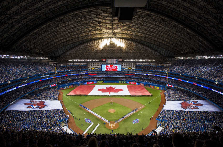 A wide view of the Canadian flag before the start of the Toronto Blue Jays home opener against the Milwaukee Brewers at Rogers Centre. (Photo by Carlos Osorio- Pool via Getty Images)