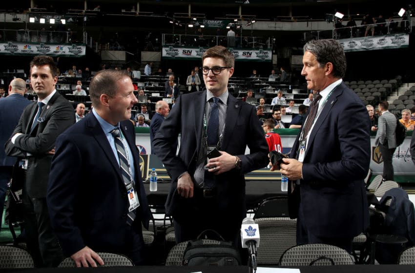 John Lilley, Kyle Dubas and Brendan Shanahan of the Toronto Maple Leafs. (Photo by Bruce Bennett/Getty Images)