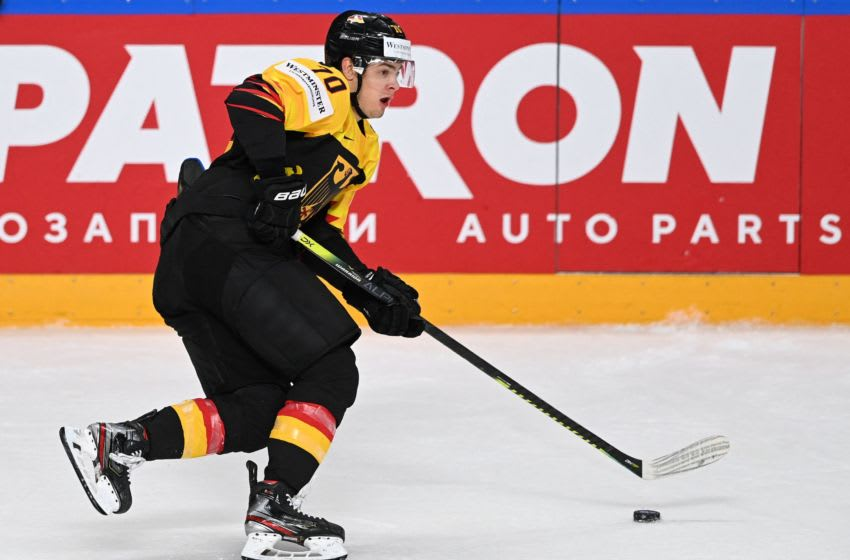 Germany's forward John Peterka controls the puck during the IIHF Men's Ice Hockey World Championships preliminary round Group B match between Germany and Finland, at the Arena Riga in Riga, Latvia, on May 29, 2021. (Photo by Gints IVUSKANS / AFP) (Photo by GINTS IVUSKANS/AFP via Getty Images)