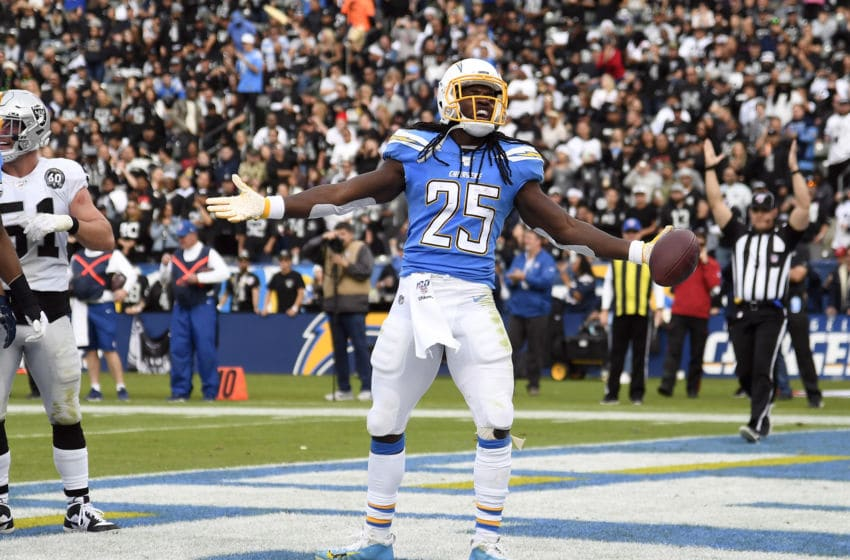 CARSON, CA - DECEMBER 22: Running back Melvin Gordon #25 of the Los Angeles Chargers celebrates after scoring a touchdown against Oakland Raiders during the first half at Dignity Health Sports Park on December 22, 2019 in Carson, California. (Photo by Kevork Djansezian/Getty Images)