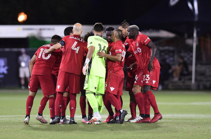 Toronto FC huddle. (Photo by Emilee Chinn/Getty Images)