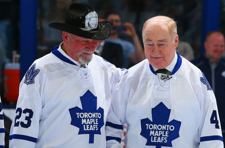 Eddie Shack and Red Kelly talk during a ceremony commemorating the 50th anniversary of the Leafs 64' Stancley Cup. (Photo by Abelimages/Getty Images)