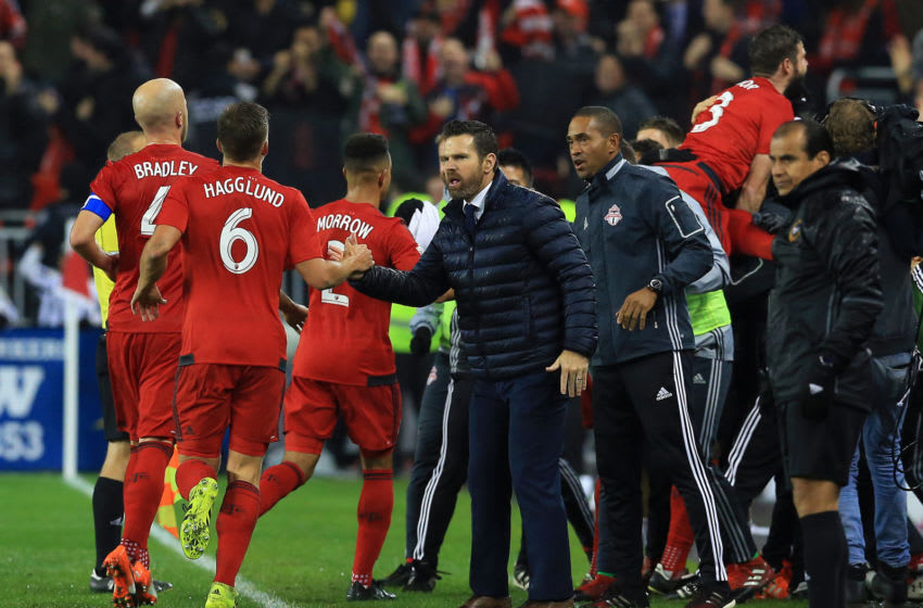 TORONTO, ON - NOVEMBER 30: Players of Toronto FC celebrate a goal by Jozy Altidore #17 as Head Coach Greg Vanney applauds during the first half of the MLS Eastern Conference Final, Leg 2 game against Montreal Impact at BMO Field on November 30, 2016 in Toronto, Ontario, Canada. (Photo by Vaughn Ridley/Getty Images)