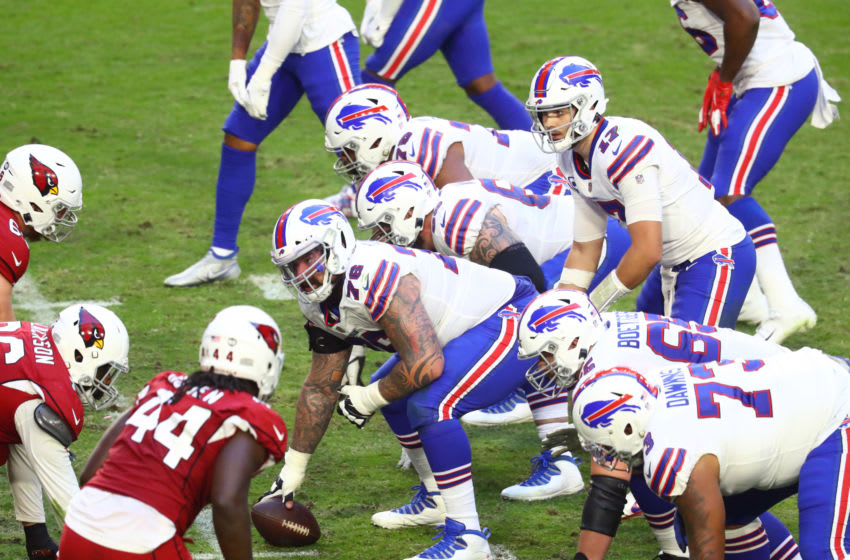 Buffalo Bills center Jon Feliciano (76) prepares to snap the ball to quarterback Josh Allen (17). (Mark J. Rebilas-USA TODAY Sports)