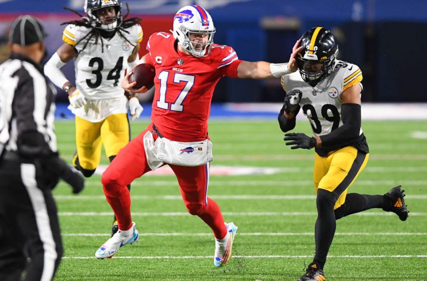 Buffalo Bills quarterback Josh Allen (17) stiff-arms Pittsburgh Steelers free safety Minkah Fitzpatrick.