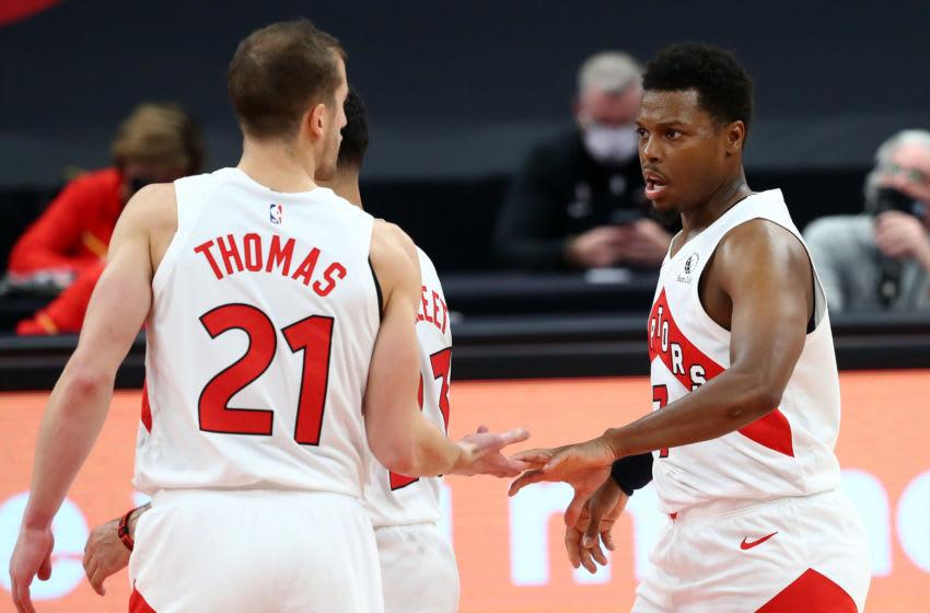 Toronto Raptors guard Kyle Lowry (7), Toronto Raptors guard Matt Thomas (21) and Toronto Raptors guard Fred VanVleet (23) high five against the Miami Heat. (Kim Klement-USA TODAY Sports)