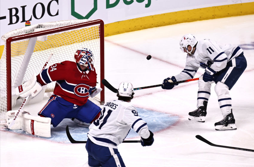 Montreal Canadiens goaltender Jake Allen (34) makes save against Toronto Maple Leafs left wing Zach Hyman (11) during the second period at Bell Centre. (Jean-Yves Ahern-USA TODAY Sports)