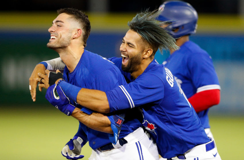 May 1, 2021; Dunedin, Florida, CAN; Toronto Blue Jays center fielder Randal Grichuk (left) celebrate with left fielder Lourdes Gurriel Jr. (right) after hitting a walk off single against the Atlanta Braves in the tenth inning at TD Ballpark. Mandatory Credit: Nathan Ray Seebeck-USA TODAY Sports