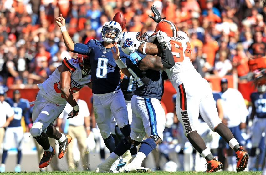 Sep 20, 2015; Cleveland, OH, USA; Tennessee Titans quarterback Marcus Mariota (8) gets the ball knocked loose while attempting a pass during the fourth quarter against the Cleveland Browns at FirstEnergy Stadium. Mandatory Credit: Andrew Weber-USA TODAY Sports