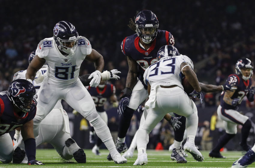 HOUSTON, TX - NOVEMBER 26: Dion Lewis #33 of the Tennessee Titans runs the ball defended by Jadeveon Clowney #90 of the Houston Texans in the second half at NRG Stadium on November 26, 2018 in Houston, Texas. (Photo by Tim Warner/Getty Images)