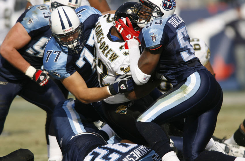 Titan defenders Keith Bulluck (r) and Sean Conover make a tackle on Maurice Jones-Drew during 1st-half action between the Jacksonville Jaguars and Tennessee Titans at LP Field in Nashville, Tennessee on December 17, 2006. Tennessee won 24-17. (Photo by Joe Murphy/NFLPhotoLibrary)