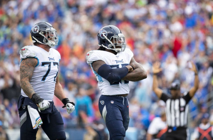 NASHVILLE, TN - OCTOBER 06: Derrick Henry #22 of the Tennessee Titans celebrates a third quarter touchdown with Taylor Lewan #77 against the Buffalo Bills at Nissan Stadium on October 6, 2019 in Nashville, Tennessee. Buffalo defeats Tennessee 14-7. (Photo by Brett Carlsen/Getty Images)