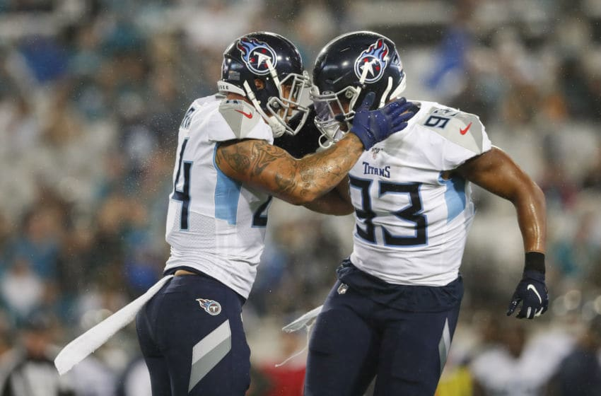 JACKSONVILLE, FLORIDA - SEPTEMBER 19: Kenny Vaccaro #24 of the Tennessee Titans congratulates Reggie Gilbert #93 after a tackle against the Jacksonville Jaguars during the second quarter against the Jacksonville Jaguars at TIAA Bank Field on September 19, 2019 in Jacksonville, Florida. (Photo by James Gilbert/Getty Images)