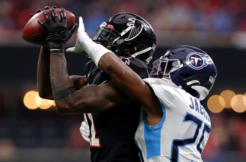 ATLANTA, GEORGIA - SEPTEMBER 29: Julio Jones #11 of the Atlanta Falcons pulls in this reception against Adoree' Jackson #25 of the Tennessee Titans at Mercedes-Benz Stadium on September 29, 2019 in Atlanta, Georgia. (Photo by Kevin C. Cox/Getty Images)