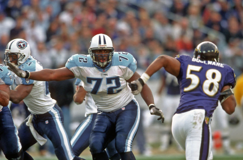BALTIMORE, MD - DECEMBER 5: Offensive lineman Brad Hopkins #72 of the Tennessee Titans watches linebacker Peter Boulware #58 of the Baltimore Ravens as he blocks during a game at PSINet Stadium on December 5, 1999 in Baltimore, Maryland. The Ravens defeated the Titans 41-14. (Photo by George Gojkovich/Getty Images)