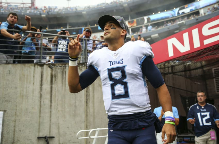 NASHVILLE, TENNESSEE - OCTOBER 06: Marcus Mariota #8 of the Tennessee Titans points up while walking onto the field before the game against the Buffalo Bills at Nissan Stadium on October 06, 2019 in Nashville, Tennessee. (Photo by Silas Walker/Getty Images)