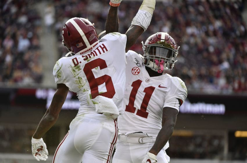 COLLEGE STATION, TEXAS - OCTOBER 12: Wide receiver DeVonta Smith #6 of the Alabama Crimson Tide celebrates with wide receiver Henry Ruggs III #11 of the Alabama Crimson Tide after a touchdown against Texas A&M Aggies at Kyle Field on October 12, 2019 in College Station, Texas. (Photo by Logan Riely/Getty Images)