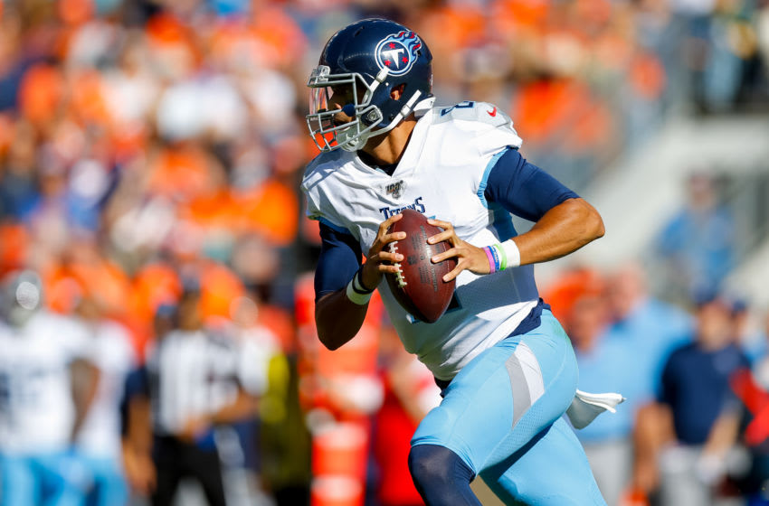 DENVER, CO - OCTOBER 13: Quarterback Marcus Mariota #8 of the Tennessee Titans scrambles with the football against the Denver Broncos during the second quarter at Empower Field at Mile High on October 13, 2019 in Denver, Colorado. (Photo by Justin Edmonds/Getty Images)