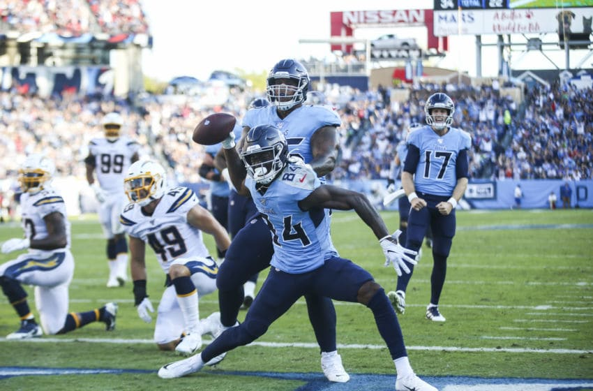 NASHVILLE, TENNESSEE - OCTOBER 20: Corey Davis #84 of the Tennessee Titans spikes the ball after scoring a touchdown against the Los Angeles Chargers to tie the game during the second quarter at Nissan Stadium on October 20, 2019 in Nashville, Tennessee. (Photo by Silas Walker/Getty Images)