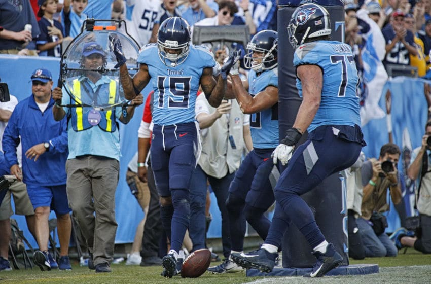 NASHVILLE, TENNESSEE - OCTOBER 20: Tajae Sharpe #19 of the Tennessee Titans reacts after scoring a touchdown during the second half of a game against the Los Angeles Chargers at Nissan Stadium on October 20, 2019 in Nashville, Tennessee. (Photo by Frederick Breedon/Getty Images)