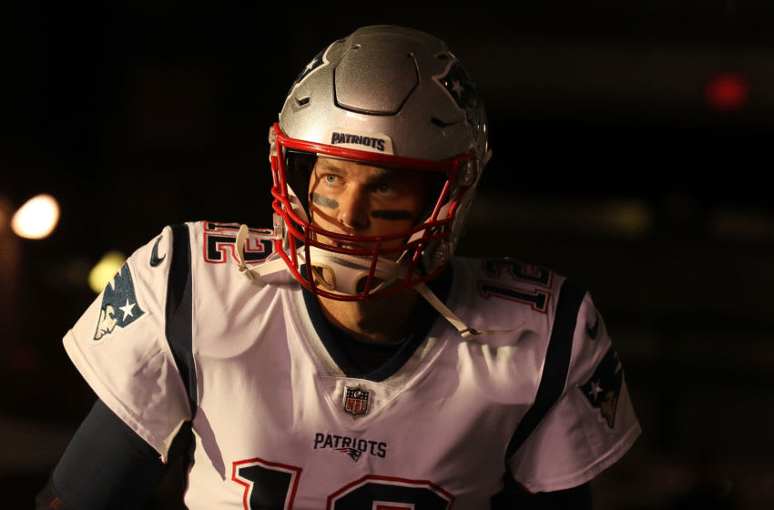 EAST RUTHERFORD, NEW JERSEY - OCTOBER 21: Quarterback Tom Brady #12 of the New England Patriots walks onto the field before the game against the New York Jets at MetLife Stadium on October 21, 2019 in East Rutherford, New Jersey. (Photo by Al Bello/Getty Images)