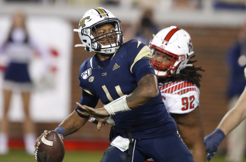 ATLANTA, GA - NOVEMBER 21: James Graham #4 of the Georgia Tech Yellow Jackets is pressured by Larrell Murchison #92 of the North Carolina State Wolfpack during the second half at Bobby Dodd Stadium on November 21, 2019 in Atlanta, Georgia. (Photo by Todd Kirkland/Getty Images)