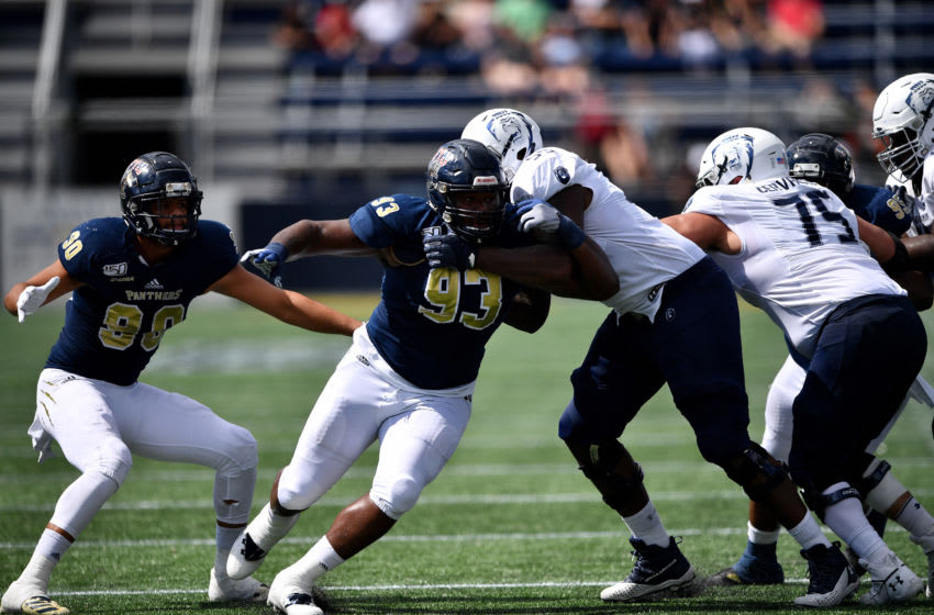 MIAMI, FLORIDA - NOVEMBER 02: Teair Tart #93 of the FIU Golden Panthers in action against the Old Dominion Monarchs in the first half at Ricardo Silva Stadium on November 02, 2019 in Miami, Florida. (Photo by Mark Brown/Getty Images)