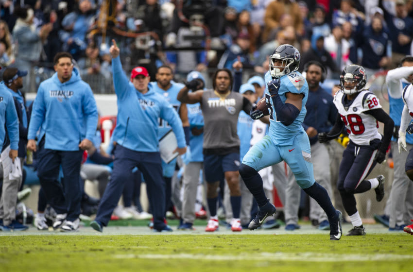 NASHVILLE, TN - DECEMBER 15: Jonnu Smith #81 of the Tennessee Titans carries the ball for a first down during the fourth quarter against the Houston Texans at Nissan Stadium on December 15, 2019 in Nashville, Tennessee. Houston defeats Tennessee 24-21. (Photo by Brett Carlsen/Getty Images)