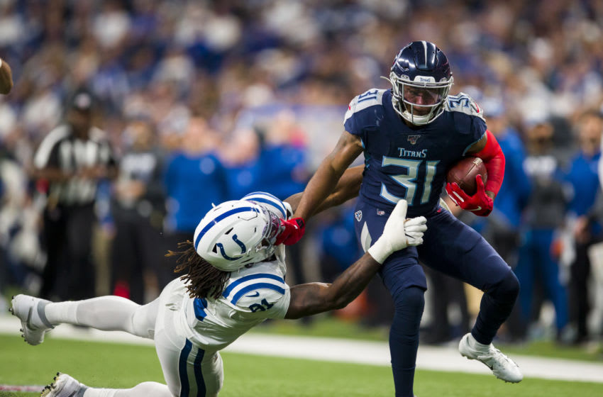 INDIANAPOLIS, IN - DECEMBER 01: Kevin Byard #31 of the Tennessee Titans delivers a stiff arm on Mo Alie-Cox #81 of the Indianapolis Colts as he runs with an interception during the third quarter at Lucas Oil Stadium on December 1, 2019 in Indianapolis, Indiana. Tennessee defeats Indianapolis 31-17. (Photo by Brett Carlsen/Getty Images)