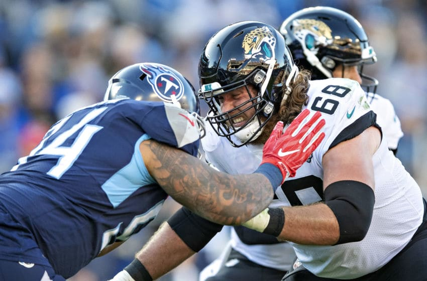 NASHVILLE, TN - NOVEMBER 24: Andrew Norwell #68 of the Jacksonville Jaguars blocks Austin Johnson #94 of the Tennessee Titans during the first half at Nissan Stadium on November 24, 2019 in Nashville, Tennessee. The Titans defeated the Jaguars 42-20. (Photo by Wesley Hitt/Getty Images)