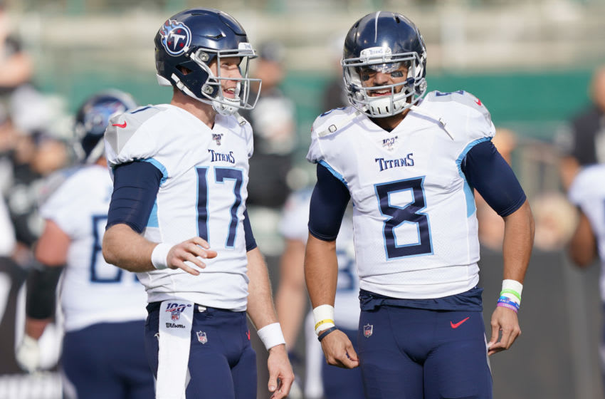 OAKLAND, CALIFORNIA - DECEMBER 08: Ryan Tannehill #17 and Marcus Mariota #8 of the Tennessee Titans standing on the field together prior to the start of an NFL football game against the Oakland Raiders at RingCentral Coliseum on December 08, 2019 in Oakland, California. (Photo by Thearon W. Henderson/Getty Images)