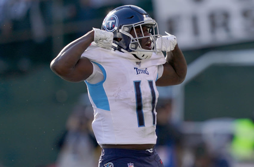 OAKLAND, CALIFORNIA - DECEMBER 08: A.J. Brown #11 of the Tennessee Titans celebrates after he scored a touchdown against the Oakland Raiders during the first half of an NFL football game at RingCentral Coliseum on December 08, 2019 in Oakland, California. (Photo by Thearon W. Henderson/Getty Images)