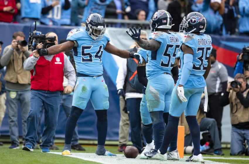 NASHVILLE, TN - DECEMBER 15: Rashaan Evans #54 of the Tennessee Titans celebrates with Jayon Brown #55 and Tramaine Brock #35 during the third quarter against the Houston Texans at Nissan Stadium on December 15, 2019 in Nashville, Tennessee. Houston defeats Tennessee 24-21. (Photo by Brett Carlsen/Getty Images)