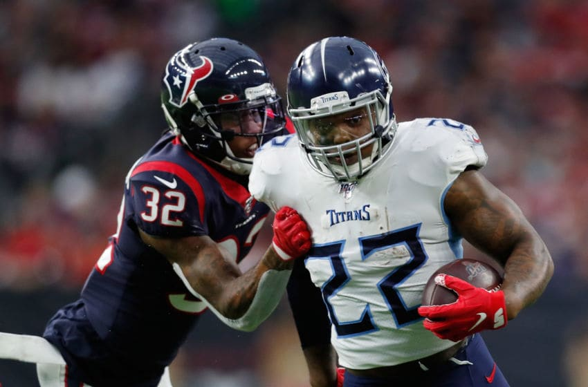 HOUSTON, TEXAS - DECEMBER 29: Derrick Henry #22 of the Tennessee Titans is pursued by Lonnie Johnson #32 of the Houston Texans during the first half at NRG Stadium on December 29, 2019 in Houston, Texas. (Photo by Tim Warner/Getty Images)