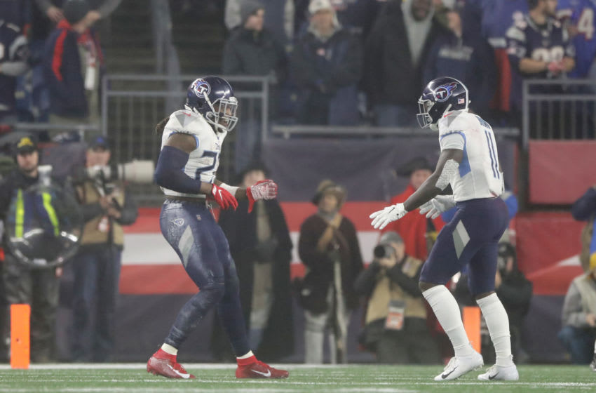 FOXBOROUGH, MASSACHUSETTS - JANUARY 04: Derrick Henry #22 of the Tennessee Titans celebrates his touchdown with teammate A.J. Brown #11 against the New England Patriots in the second quarter of the AFC Wild Card Playoff game at Gillette Stadium on January 04, 2020 in Foxborough, Massachusetts. (Photo by Elsa/Getty Images)
