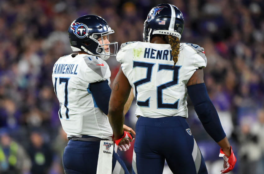 BALTIMORE, MARYLAND - JANUARY 11: Quarterback Ryan Tannehill #17 of the Tennessee Titans and Derrick Henry #22 talk on the field during the AFC Divisional Playoff game against the Baltimore Ravens at M&T Bank Stadium on January 11, 2020 in Baltimore, Maryland. (Photo by Will Newton/Getty Images)