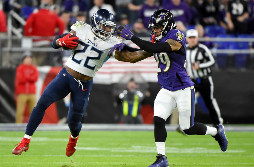 BALTIMORE, MARYLAND - JANUARY 11: Derrick Henry #22 of the Tennessee Titans carries the ball against Earl Thomas #29 of the Baltimore Ravens during the AFC Divisional Playoff game at M&T Bank Stadium on January 11, 2020 in Baltimore, Maryland. (Photo by Will Newton/Getty Images)