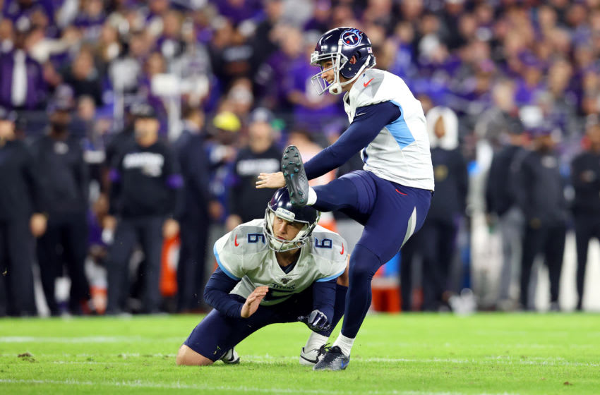 BALTIMORE, MARYLAND - JANUARY 11: Greg Joseph #7 of the Tennessee Titans attempts a point after try during the first half against the Baltimore Ravens in the AFC Divisional Playoff game at M&T Bank Stadium on January 11, 2020 in Baltimore, Maryland. (Photo by Rob Carr/Getty Images)