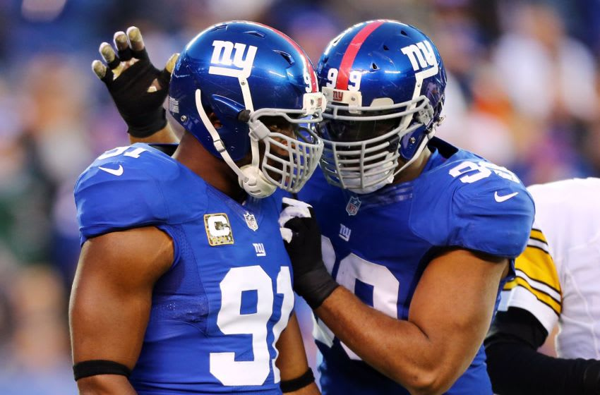 EAST RUTHERFORD, NJ - NOVEMBER 04: (NEW YORK DAILIES OUT) Justin Tuck #91 of the New York Giants celebrates a sack against the Pittsburgh Steelers with teammate Chris Canty #99 at MetLife Stadium on November 4, 2012 in East Rutherford, New Jersey. The Steelers defeated the Giants 24-20. (Photo by Jim McIsaac/Getty Images)