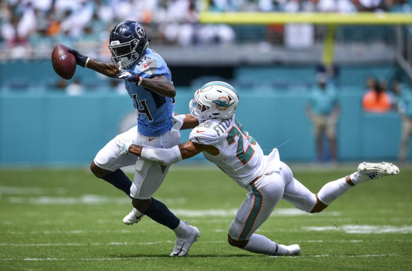 MIAMI, FL - SEPTEMBER 09: Minkah Fitzpatrick #29 of the Miami Dolphins makes the tackle on Corey Davis #84 of the Tennessee Titans during the first quarter at Hard Rock Stadium on September 9, 2018 in Miami, Florida. (Photo by Mark Brown/Getty Images)