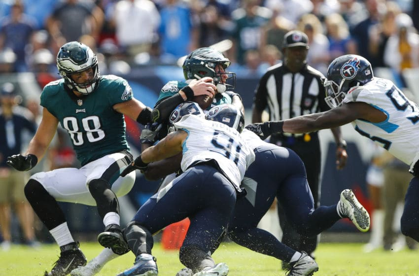NASHVILLE, TN - SEPTEMBER 30: Carson Wentz #11 of the Philadelphia Eagles is sacked by Derrick Morgan #91 and Jayon Brown #55 of the Tennessee Titans during the fourth quarter at Nissan Stadium on September 30, 2018 in Nashville, Tennessee. (Photo by Wesley Hitt/Getty Images)