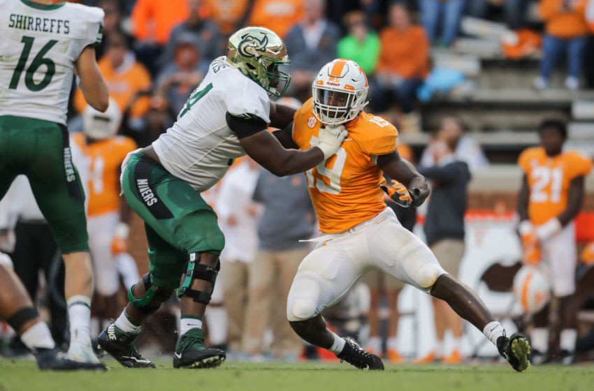 KNOXVILLE, TN - NOVEMBER 3: Nate Davis #64 of the Charlotte 49ers pass blocks Defensive lineman Darrell Taylor #19 of the Tennessee Volunteers during the game between the Charlotte 49ers and the Tennessee Volunteers at Neyland Stadium on November 3, 2018 in Knoxville, Tennessee. Tennessee won the game 14-3. (Photo by Donald Page/Getty Images)