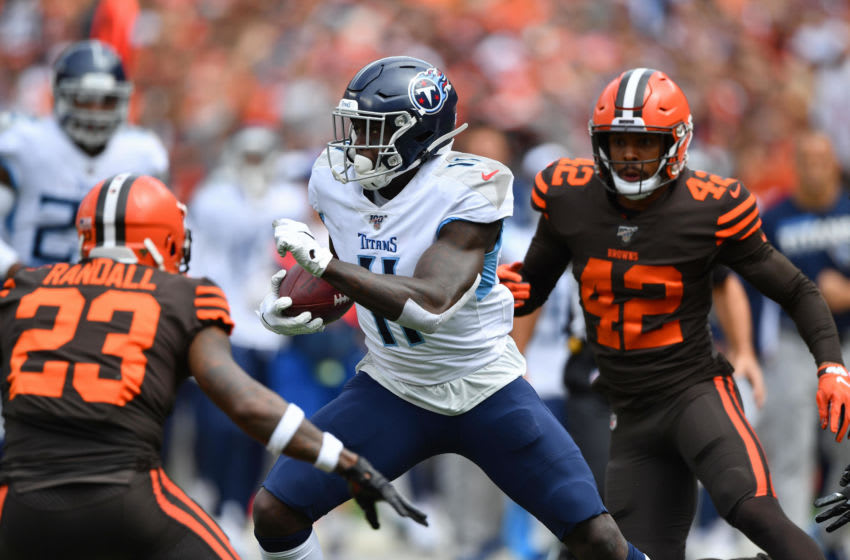 CLEVELAND, OH - SEPTEMBER 08: A.J. Brown #11 of the Tennessee Titans looks for running room in the first quarter as Damarious Randall #23 of the Cleveland Browns and Morgan Burnett #42 of the Cleveland Browns close in at FirstEnergy Stadium on September 08, 2019 in Cleveland, Ohio . (Photo by Jamie Sabau/Getty Images)