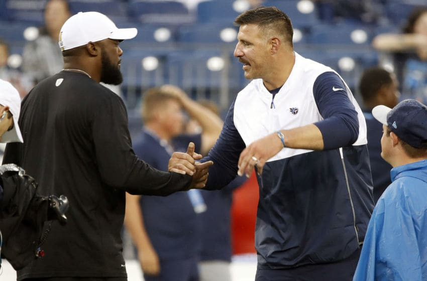 NASHVILLE, TENNESSEE - AUGUST 25: Head coach Mike Vrabel of the Tennessee Titans welcomes head coach Mike Tomlin of the Pittsburgh Steelers prior to an NFL preseason game at Nissan Stadium on August 25, 2019 in Nashville, Tennessee. (Photo by Frederick Breedon/Getty Images)