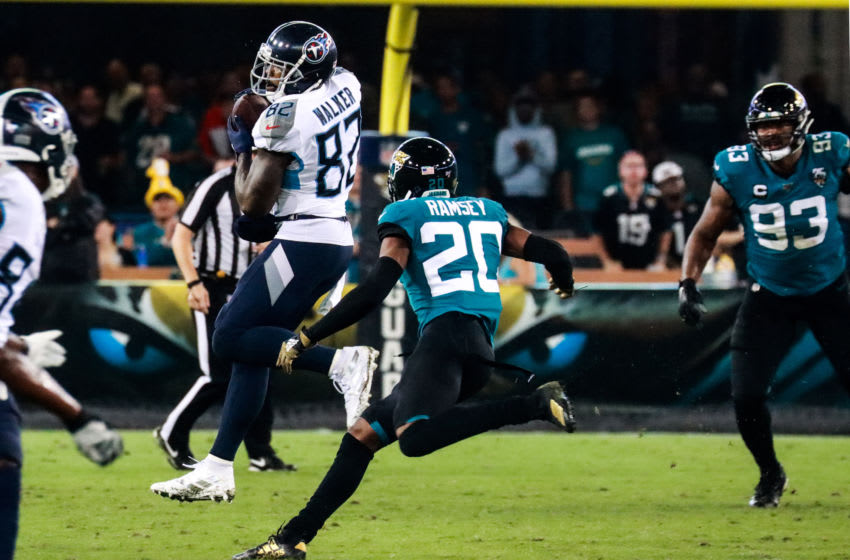 JACKSONVILLE, FLORIDA - SEPTEMBER 19: Tight end Delanie Walker 82 of the Tennessee Titans dodges cornerback Jalen Ramsey 20 of the Jacksonville Jaguars in the second quarter at TIAA Bank Field on September 19, 2019 in Jacksonville, Florida. (Photo by Harry Aaron/Getty Images)