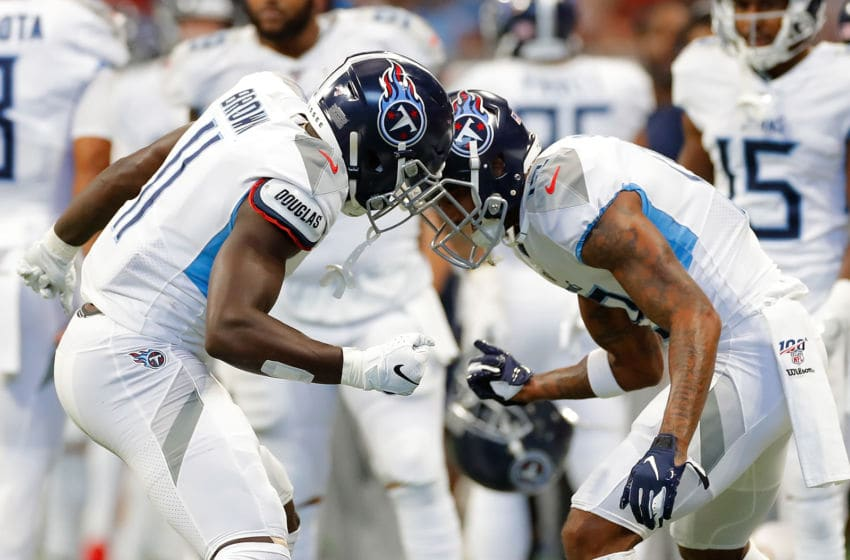 ATLANTA, GEORGIA - SEPTEMBER 29: A.J. Brown #11 of the Tennessee Titans reacts after pulling in a touchdown reception against the Atlanta Falcons in the first half with Tajae Sharpe #19 at Mercedes-Benz Stadium on September 29, 2019 in Atlanta, Georgia. (Photo by Kevin C. Cox/Getty Images)