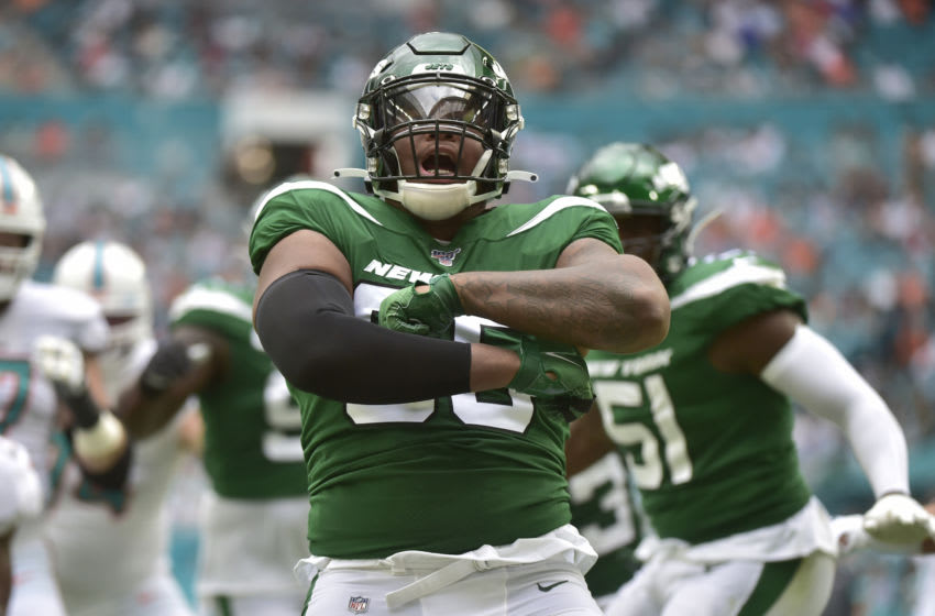 MIAMI, FL - NOVEMBER 03: Quinnen Williams #95 of the New York Jets celebrates after sacking Ryan Fitzpatrick #14 of the Miami Dolphins during the first quarter of the game at Hard Rock Stadium on November 3, 2019 in Miami, Florida. (Photo by Eric Espada/Getty Images)